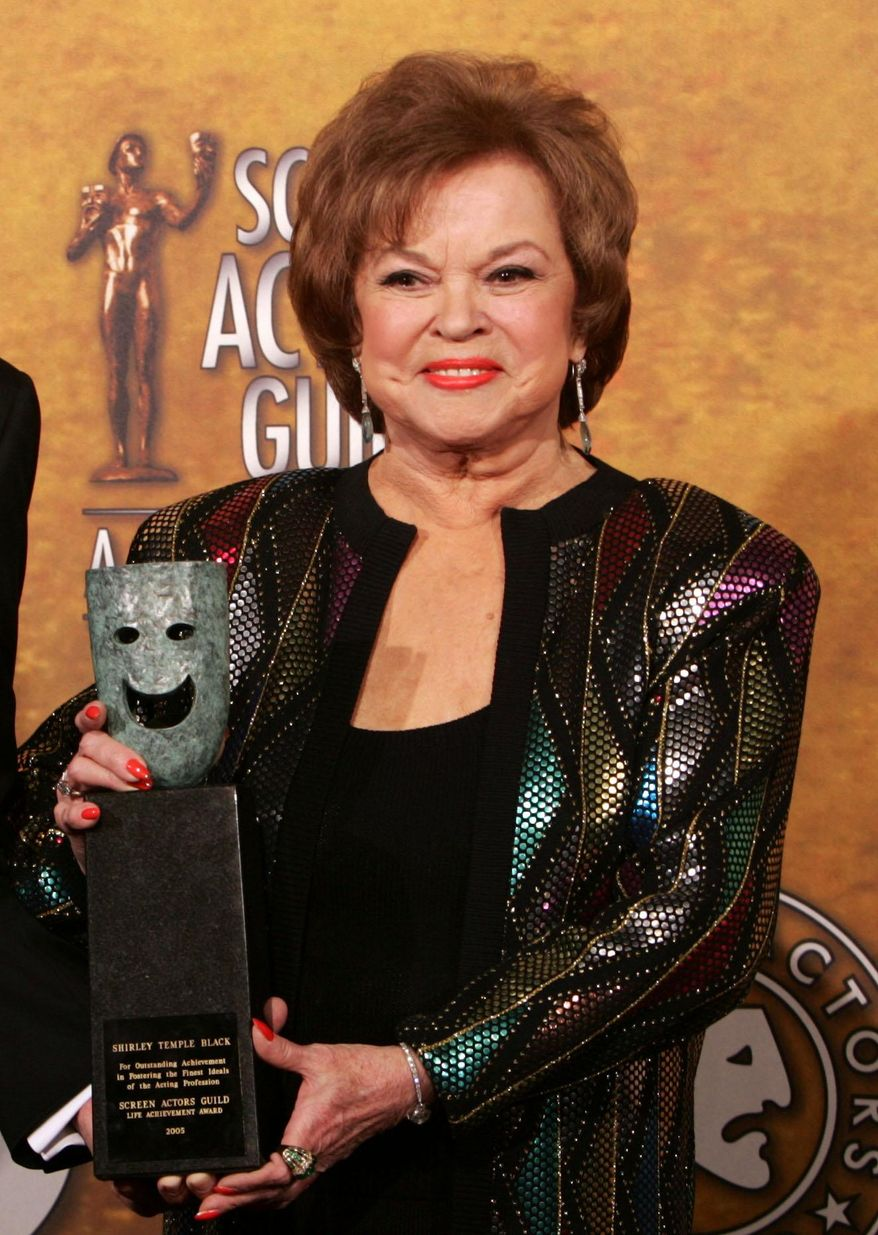 FILE - In this Jan. 29, 2006 file photo, Shirley Temple Black poses with the Screen Actors Guild Awards 42st annual life achievement award at the 12th Annual Screen Actors Guild Awards, in Los Angeles. Shirley Temple, the curly-haired child star who put smiles on the faces of Depression-era moviegoers, has died. She was 85. (AP Photo/Reed Saxon, File)