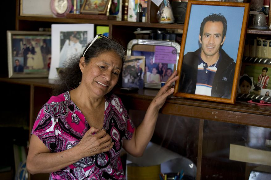 In this Feb. 5, 2014, photo, Maria Gonzalez, touches a picture of her son Cesar, during an interview with The Associated Press inside her home in Yautepec, Mexico. In 2012. Cesar, a 33-year-old architect and engineer, was kidnapped as he drove through Cuernavaca to visit his family in Yautepec. The family got together $10,000 and left it in packets of $2,000 in a cereal box in Cuernavaca. Five days later he was found dead in the trunk of his car. (AP Photo/Eduardo Verdugo)