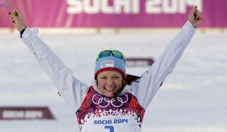 Norway's Maiken Caspersen Falla celebrates winning the gold medal during the flower ceremony for the women's cross-country sprint the 2014 Winter Olympics, Tuesday, Feb. 11, 2014, in Krasnaya Polyana, Russia. (AP Photo/Matthias Schrader)