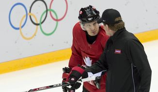 Team Canada's head coach Mike Babcock, right,  speaks with Sidney Crosby during practice at the Sochi Winter Olympics Tuesday Feb. 11, 2014, in Sochi, Russia. (AP Photo/The Canadian Press, Adrian Wyld)