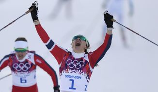 Norway's Maiken Caspersen Falla crosses the finish line to win gold in the final of the women's cross-country sprint at the 2014 Winter Olympics, Tuesday, Feb. 11, 2014, in Krasnaya Polyana, Russia. (AP Photo/Matthias Schrader)
