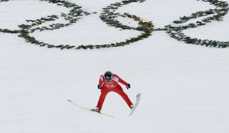 Norway's Haavard Klemetsen soars through the air during a men's nordic combined training session at the 2014 Winter Olympics, Tuesday, Feb. 11, 2014, in Krasnaya Polyana, Russia. (AP Photo/Dmitry Lovetsky)