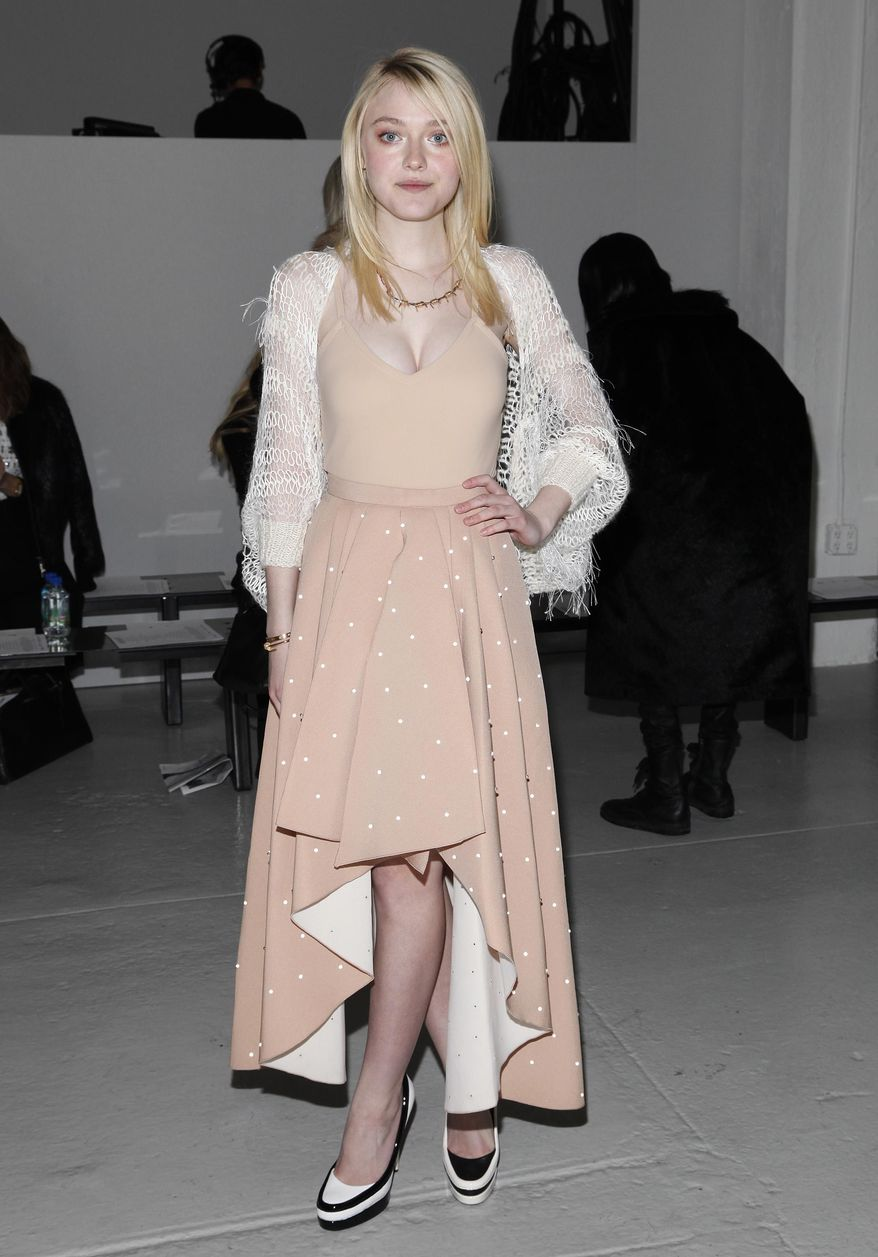 Actress Dakota Fanning attends the Rodarte 2014 Fall/Winter Collection during Mercedes Benz Fashion Week on Tuesday, Feb. 11, 2014, in New York. (Photo by Amy Sussman/Invision/AP)