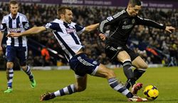 West Brom's Gareth McAuley, left, competes for the ball with Chelsea's  Fernando Torres during the English Premier League soccer match between West Bromwich Albion and Chelsea at The Hawthorns Stadium in West Bromwich, England, Tuesday, Feb. 11, 2014.  (AP Photo/Rui Vieira)
