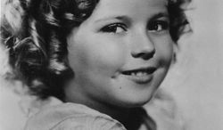 FILE - In this Nov. 1936 file photo, 8-year-old U.S. American child movie star Shirley Temple is portrayed in Hollywood, Ca., USA. Shirley Temple, the curly-haired child star who put smiles on the faces of Depression-era moviegoers, has died. She was 85. Publicist Cheryl Kagan says Temple, known in private life as Shirley Temple Black, died surrounded by family at her home near San Francisco. (AP Photo/File)