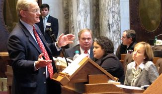 Assembly Democratic Minority Leader Peter Barca speaks out against Gov. Scott Walker's proposed $504 million property and income tax cut proposal on Tuesday, Feb. 11, 2014, in Madison, Wis. (AP Photo/Scott Bauer)