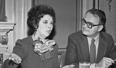 In this Oct. 27, 1984, file photo, Environmental Protection Agency administrator William Ruckelshaus listens to Shirley Temple Black before he speaks to the Commonwealth Club in San Francisco. Black is president of the club, and Ruckelshaus spoke about environmental policies under the Reagan administration. Temple, who died at her home near San Francisco, Monday, Feb. 10, 2014, at 85, sang, danced, sobbed and grinned her way into the hearts of Depression-era moviegoers and remains the ultimate child star decades later. (AP Photo/Sal Veder, File)