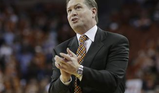 Oklahoma State coach Travis Ford talks to his players during the first half on an NCAA college basketball game against Texas, Tuesday, Feb. 11, 2014, in Austin, Texas. Texas won 87-68. (AP Photo/Eric Gay)