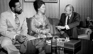 "In this Monday, Oct. 13, 1975, file photo, singer-songwriter Marvin Gaye, left, sits with United Nations Secretary-General Kurt Waldheim, right, and Shirley Temple Black, U.S. Ambassador to Ghana, at the United Nations. Gaye is donating proceeds from his Sunday performance ""Salute to the U.N."" to UNESCO for an African literacy campaign. Temple, who died at her home near San Francisco, Monday, Feb. 10, 2014, at 85, sang, danced, sobbed and grinned her way into the hearts of Depression-era moviegoers and remains the ultimate child star decades later. (AP Photo/File)"