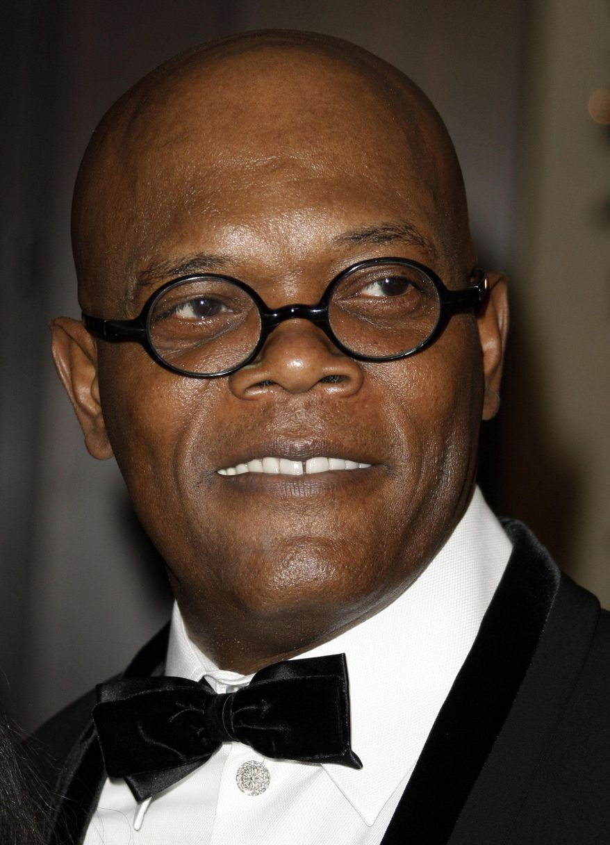 """File-This Dec. 1, 2008 file photo shows actor Samuel L. Jackson arriving at the American Cinematheque Award gala honoring him in Beverly Hills, Calif.   Los Angeles newscaster has apologized to Jackson for confusing him with Laurence Fishburne. KTLA entertainment reporter Sam Rubin was interviewing Jackson on Monday Feb. 10, 2014, about the forthcoming film """"Robocop"""" when he asked the actor if he'd gotten a lot of reaction to his Super Bowl commercial. (AP Photo/Matt Sayles, File)"""