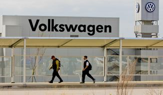 FILE - In this March 21, 2012, file photo, workers walk by the Volkswagen AG plant in Chattanooga, Tenn. Workers at the plant will decide in a three-day vote Wednesday, Feb. 12, 2014, whether they want to be represented by the United Auto Workers union. (AP Photo/Erik Schelzig, file)