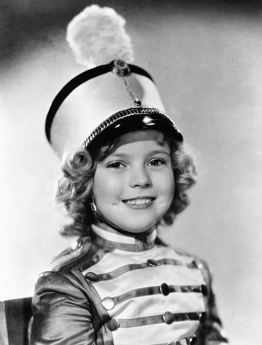 FILE - In this 1936 file photo, actress Shirley Temple is photographed as she appeared in Poor Little Rich Girl. Temple, who was born in 1928 and began acting at the age of three, received an honorary Academy Award in 1934 for her contributions as a child film star.  Shirley Temple, the curly-haired child star who put smiles on the faces of Depression-era moviegoers, has died. She was 85. Publicist Cheryl Kagan says Temple, known in private life as Shirley Temple Black, died surrounded by family at her home near San Francisco. (AP Photo/File)