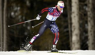 United States' Kikkan Randall competes during the women's qualifications of the cross-country sprint at the 2014 Winter Olympics, Tuesday, Feb. 11, 2014, in Krasnaya Polyana, Russia. (AP Photo/Felipe Dana)