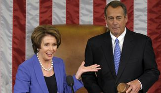 House Minority Leader Nancy Pelosi of California gestures after passing the gavel House Speaker John Boehner of Ohio, who was re-elected as House Speaker of the 113th Congress on Capitol Hill in Washington on Jan. 3, 2013. (Associated Press) **FILE**