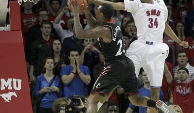 SMU Mustangs center Yanick Moreira (35) blocks a shot by Cincinnati Bearcats guard Sean Kilpatrick (23) in the first half of American Athletic Conference NCCA Basketball action at Moody Coliseum on the SMU campus in University Park, Texas on Saturday, February 8, 2014. (AP Photo/The Dallas Morning News, Brad Loper)