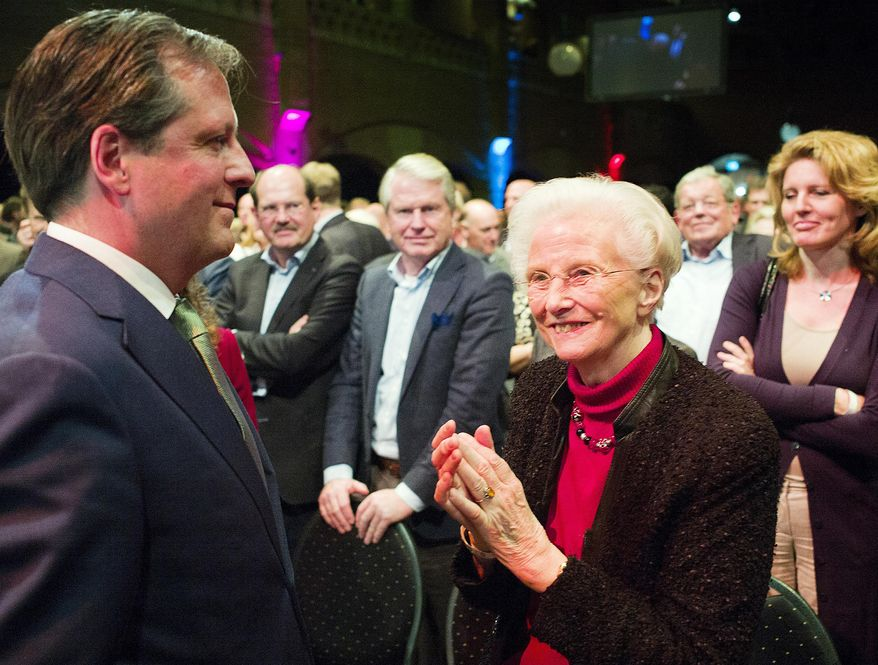 In this photo taken Saturday, Feb. 8, 2014, Els Borst, front right, applauds after a speech from Alexander Pechtold, front left, during a D66 party congress in Amsterdam. Els Borst, a former health minister who drafted the Netherlands' 2002 law permitting euthanasia, has been found dead in her garage on Monday night, police said Tuesday, Feb. 11, 2014. She was 81. Utrecht police spokesman Thomas Aling told state broadcaster NOS that police had not ruled out a natural cause of death, an accident or a crime, but had no reason to suspect a crime. She is survived by three children. (AP Photo/Jiri Buller)