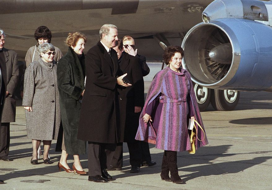 In this Tuesday, Feb. 6, 1990, file photo, U.S. Ambassador to Czechoslovakia Shirley Temple Black, right, leads U.S. Secretary of State James Baker and wife Susan from the plane at Prague Airport, in Prague. Baker arrived for a one-day visit to Prague. Temple, who died at her home near San Francisco, Monday, Feb. 10, 2014, at 85, sang, danced, sobbed and grinned her way into the hearts of Depression-era moviegoers and remains the ultimate child star decades later. (AP Photo/File)