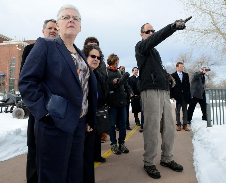 John Stokes, right, director of the Natural Areas Department for the city of Fort Collins, points out the Poudre River to Environmental Protection Agency Administrator Gina McCarthy, left; David Agnew, left rear, director of the White House's intergovernmental affairs office; and Nancy Sutley (in sunglasses, behind McCarthy), chair of the  White House Council on Environmental Quality, in Fort Collins, Colo., Tuesday Feb. 11, 2014. (AP Photo/The Coloradoan, V. Richard Haro)