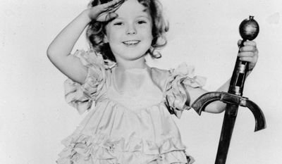 "FILE - In this 1933 file photo, child actress Shirley Temple is seen in her role as ""Little Miss Marker."" Shirley Temple, the curly-haired child star who put smiles on the faces of Depression-era moviegoers, has died. She was 85. Publicist Cheryl Kagan says Temple, known in private life as Shirley Temple Black, died Monday night, Feb. 10, 2014, surrounded by family at her home near San Francisco. (AP Photo/File)"