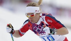 Norway's Astrid Uhrenholdt Jacobsen starts the women's qualification of the cross-country sprint at the 2014 Winter Olympics, Tuesday, Feb. 11, 2014, in Krasnaya Polyana, Russia. (AP Photo/Matthias Schrader)