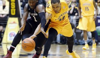 Southern Illinois forward Jalen Pendleton (1 )and Wichita State guard Tekele Cotton (32) scramble for the ball in the final seconds of the first half of an NCAA college basketball game Tuesday, Feb. 11, 2014, in Wichita, Kan. (AP Photo/The Wichita Eagle, Jaime Green) LOCAL TV OUT; MAGS OUT LOCAL RADIO OUT; LOCAL INTERNET OUT