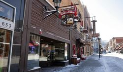 This March 12, 2009 photo shows bars along Main Street in Deadwood, S.D. A bill in the South Dakota Legislature allowing Deadwood hotel bars to serve liquor 24 hours a day is drawing the ire of saloon owners who say the measure hurts them and discourages investment in the western gambling town's downtown. (AP Photo/Rapid City Journal, Ryan Soderlin)
