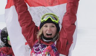 Canada's Dara Howell celebrates after taking the gold medal in the women's freestyle skiing slopestyle final at the Rosa Khutor Extreme Park at the 2014 Winter Olympics, Tuesday, Feb. 11, 2014, in Krasnaya Polyana, Russia. (AP Photo/Andy Wong)