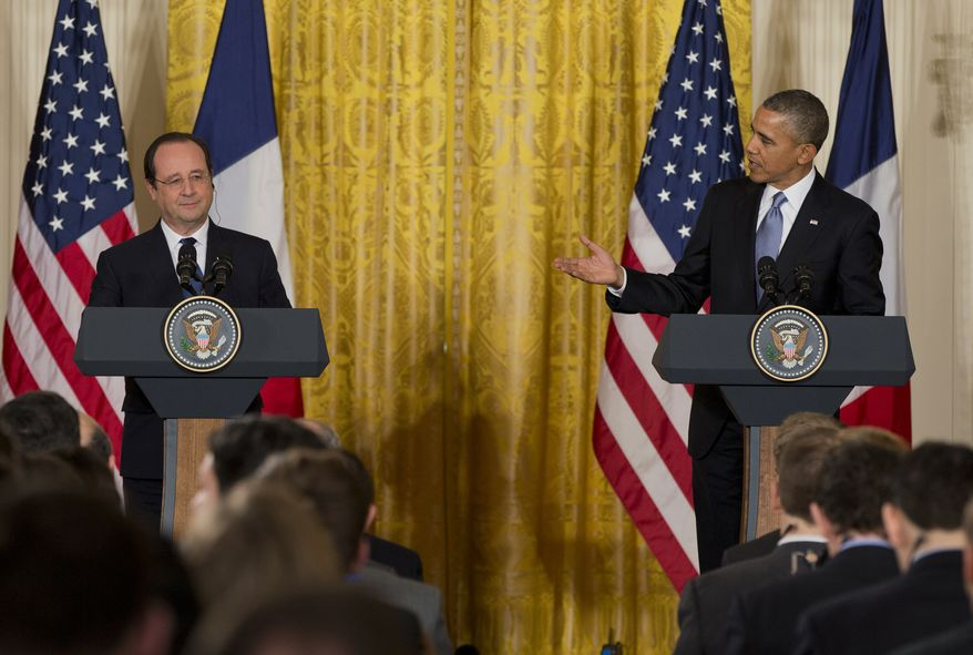 """President Barack Obama welcomes French President François Hollande during a joint news conference, as part of an official state visit, Tuesday, Feb. 11, 2014, in the East Room of the White House in Washington. Lauding the """"enduring alliance"""" between the United States and France, President Barack Obama on Tuesday welcomed President Francois Hollande to the White House for a lavish state visit. The highly anticipated trip is taking place amid swirling speculation on both sides of the Atlantic about problems in Hollande's personal life. (AP Photo/ J. Scott Applewhite)"""