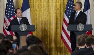 """President Barack Obama listens as French President François Hollande speaks during their joint news conference, as part of an official state visit, Tuesday, Feb. 11, 2014, in the East Room of the White House in Washington. Lauding the """"enduring alliance"""" between the United States and France, President Barack Obama on Tuesday welcomed President Francois Hollande to the White House for a lavish state visit. The highly anticipated trip is taking place amid swirling speculation on both sides of the Atlantic about problems in Hollande's personal life. (AP Photo/ J. Scott Applewhite)"""