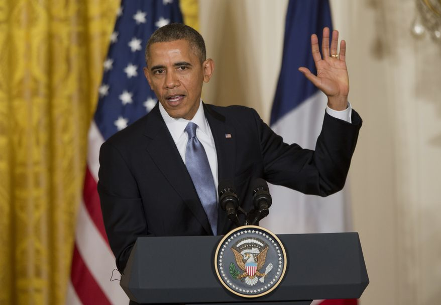 """President Barack Obama gestures during a joint news conference with French President François Hollande, as part of an official state visit, Tuesday, Feb. 11, 2014, in the East Room of the White House in Washington. Lauding the """"enduring alliance"""" between the United States and France, President Barack Obama on Tuesday welcomed President Francois Hollande to the White House for a lavish state visit. The highly anticipated trip is taking place amid swirling speculation on both sides of the Atlantic about problems in Hollande's personal life. (AP Photo/ J. Scott Applewhite)"""