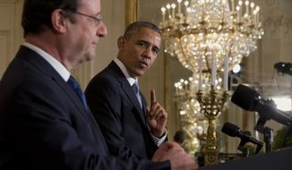 """French President Francois Hollande listens as President Barack Obama speaks during their joint news conference in the East Room of the White House, Tuesday, Feb. 11, 2014, during a state visit. Lauding the """"enduring alliance"""" between the United States and France, President Barack Obama on Tuesday welcomed President Francois Hollande to the White House for a lavish state visit. The highly anticipated trip is taking place amid swirling speculation on both sides of the Atlantic about problems in Hollande's personal life.  (AP Photo/Jacquelyn Martin)"""