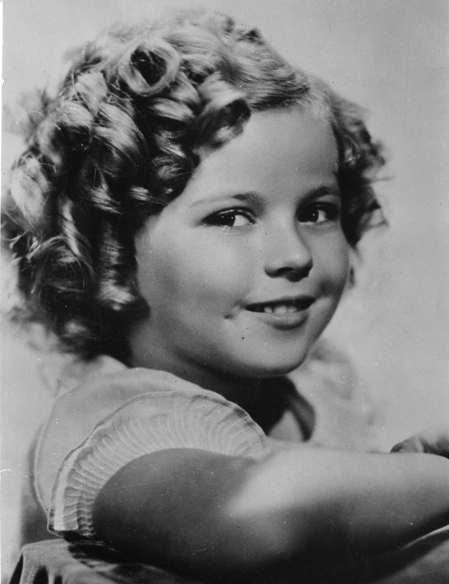 ** FILE ** In this November 1936 file photo, 8-year-old U.S. American child movie star Shirley Temple is portrayed in Hollywood, Calif. Shirley Temple, the curly-haired child star who put smiles on the faces of Depression-era moviegoers, has died. She was 85. (AP Photo/File)