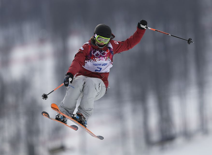Canada's Dara Howell takes a jump during the women's freestyle skiing slopestyle final at the Rosa Khutor Extreme Park, at the 2014 Winter Olympics, Tuesday, Feb. 11, 2014, in Krasnaya Polyana, Russia. (AP Photo/Sergei Grits)