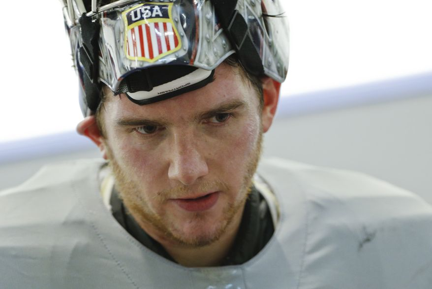 USA goaltender Jonathan Quick skates off the ice after a training session at the Bolshoy Ice Dome at the the 2014 Winter Olympics, Tuesday, Feb. 11, 2014, in Sochi, Russia. (AP Photo/Julio Cortez)