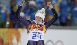 Germany's Carina Vogt celebrates winning the gold during the women's normal hill ski jumping final at the 2014 Winter Olympics, Tuesday, Feb. 11, 2014, in Krasnaya Polyana, Russia. (AP Photo/Gregorio Borgia)