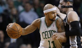 Boston Celtics guard Jerryd Bayless (11) attempts to drive around San Antonio Spurs point guard Nando de Colo during the first half of an NBA basketball game in Boston, Wednesday, Feb. 12, 2014. (AP Photo/Stephan Savoia)