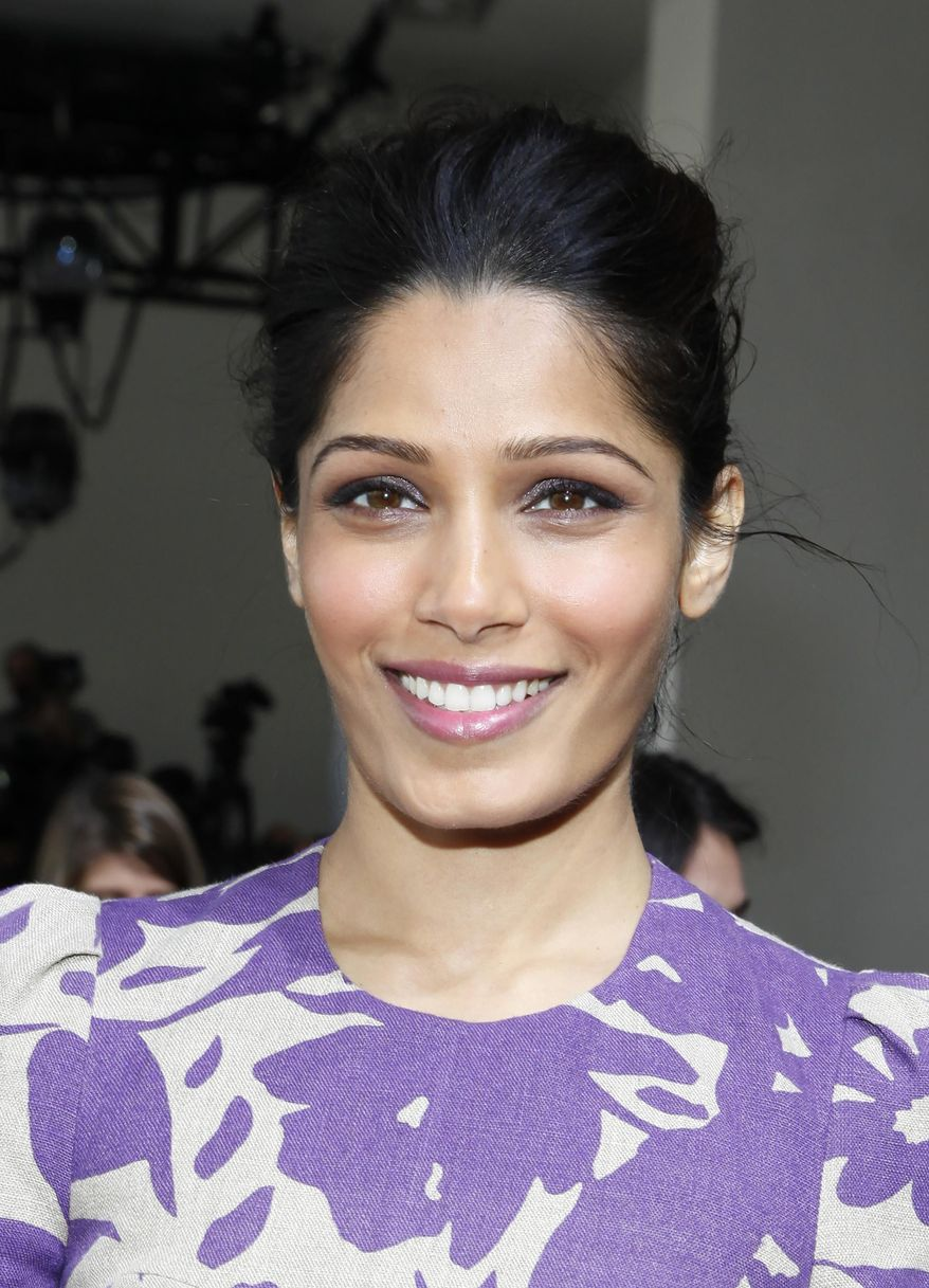 Actress Freida Pinto attends the Michael Kors 2014 Fall/Winter Collection during Mercedes Benz Fashion Week on Wednesday, Feb. 12, 2014, in New York. (Photo by Amy Sussman/Invision/AP)