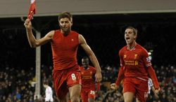 Liverpool's Steven Gerrard, left, celebrates his penalty goal against Fulham with teammate Jordan Henderson during their English Premier League soccer match at Craven Cottage, London, Wednesday, Feb. 12, 2014. (AP Photo/Sang Tan)