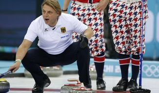 Germany's John Jahr shouts instructions from the house during men's curling competition against Norway at the 2014 Winter Olympics, Wednesday, Feb. 12, 2014, in Sochi, Russia. (AP Photo/Robert F. Bukaty)