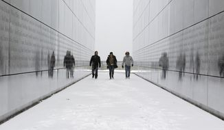 FILE - In this Tuesday, Jan. 21, 2014 file photo, tourists walk through the snow-covered Empty Sky Memorial at Liberty State Park in Jersey City, N.J. Researchers who analyzed local climate trends and hospital records on millions of Americans say there may be a link between weather and the risk for stroke. Cold weather, high humidity and big daily temperature swings brought more stroke hospitalizations. The study by researchers from Yale, Harvard and Duke universities was discussed Wednesday, Feb. 12, 2014 at a stroke conference in San Diego. (AP Photo/Julio Cortez)