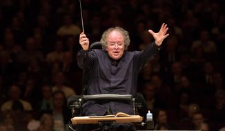 FILE - This May 19, 2013 file photo shows Metropolitan Opera Music Director James Levine leading the MET Orchestra in a concert at Carnegie Hall in New York. Levine will resume a full schedule of six stagings at the Metropolitan Opera next season, conducting on opening night for the first time since 2010 following his recovery from a back injury that caused a two-year layoff.  (AP Photo/Metropolitan Opera, Marty Sohl, file)