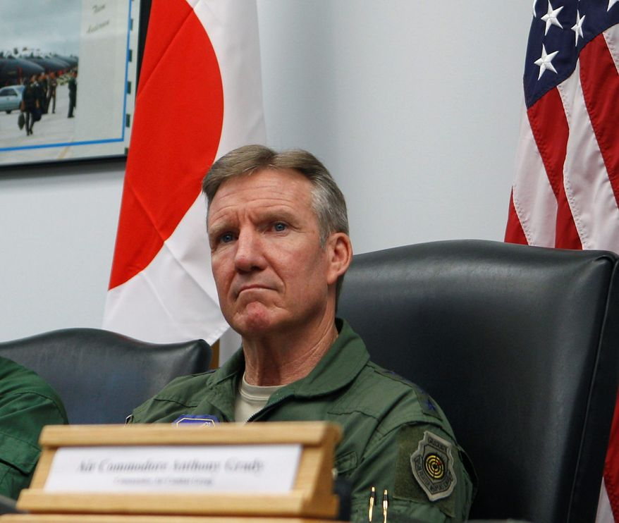 ** FILE ** In this photo taken Monday, Feb. 4, 2013, Japanese Lt. Gen. Masayuki Hironaka, U.S. Pacific Air Forces commander Gen. Herbert Carlisle and Royal Australian Air Force Air Commodore Anthony Grady speak to the media at Andersen Air Force Base on the island of Guam to kick off the beginning of the Cope North military exercises. (AP Photo/Eric Talmadge)