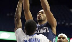 Villanova guard Darrun Hilliard, right, drives to the basket against DePaul guard Durrell McDonald (25) during the first half of an NCAA college basketball game in Rosemont, Ill., Wednesday, Feb. 12, 2014. (AP Photo/Nam Y. Huh)