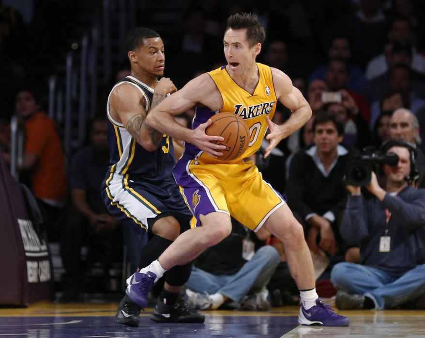 Los Angeles Lakers' Steve Nash, right, moves around Utah Jazz's Trey Burke during the first half of an NBA basketball game in Los Angeles, Tuesday, Feb. 11, 2014. (AP Photo/Danny Moloshok)