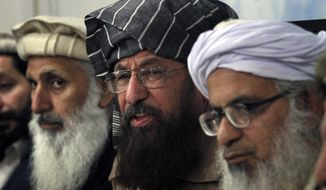 In this Monday, Feb. 3, 2014 photo, negotiators from Pakistani Taliban committee, from left, to right Ibrahim Khan, Maulana Sami-ul-Haq and Maulana Abdul Aziz, listen to a reporter during their press conference in Islamabad, Pakistan. The Pakistani government has recently opened negotiations with domestic militants called the Pakistani Taliban designed to end years of fighting in the northwest that has cost thousands of lives and forced hundreds of thousands of people to flee their homes. (AP Photo/Anjum Naveed)