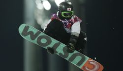 Japan's Ayumu Hirano competes in the men's snowboard halfpipe final at the Rosa Khutor Extreme Park, at the 2014 Winter Olympics, Tuesday, Feb. 11, 2014, in Krasnaya Polyana, Russia. Hirano took the silver medal.  (AP Photo/Andy Wong)