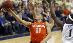 Syracuse's Tyler Ennis (11) shoots after getting past Pittsburgh's Jamel Artis (1) during the second half of an NCAA college basketball game Wednesday, Feb. 12, 2014, in Pittsburgh. (AP Photo/Keith Srakocic)