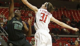 Baylor's Sune Agbuke (22) shoots over Texas Tech's Haley Schneider (31) during an NCAA college basketball game in Lubbock, Texas, Wednesday, Feb. 12, 2014. (AP Photo/The Avalanche-Journal, Tori Eichberger)
