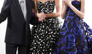 Designer Oscar de la Renta acknowledges the audience after his Fall 2014 collection show during Fashion Week in New York, Tuesday, Feb. 11, 2014. (AP Photo/Jason DeCrow)