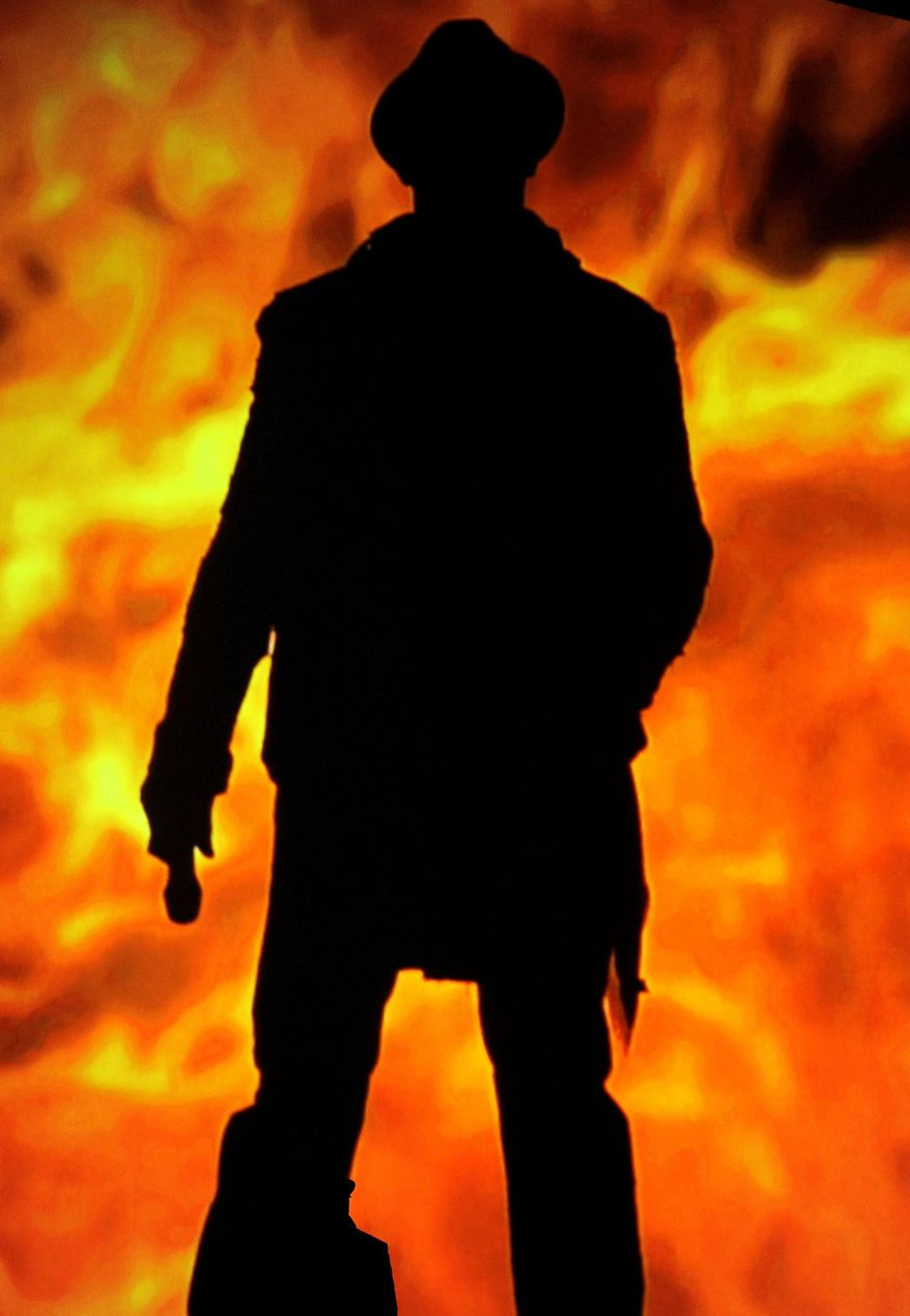 "FILE - In this Friday, Dec. 7, 2012 file photo, host Samuel L. Jackson stands on stage in front of a video screen showing fire at Spike's 10th Annual Video Game Awards at Sony Studios in Culver City, Calif. A Los Angeles newscaster apologized to Samuel L. Jackson for confusing him with fellow actor Laurence Fishburne during a live TV interview on Monday, Feb. 10, 2014. Thomas Busey, an Indiana University psychology professor who studies face recognition, says, ""There's a phenomenon called the 'other race effect,' where people in general have a tendency to confuse or fail to correctly name individuals of other races."" (Photo by Chris Pizzello/Invision/AP)"